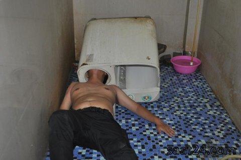 مرد چینی که در حادثه عجیبی سرش در ماشین رخت شویی گیر کرده است