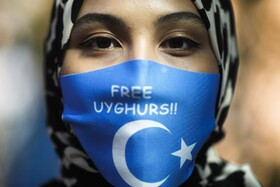 تظاهرات مسلمانان اویگور در جریان دیدار وزیرخارجه چین از آلمان